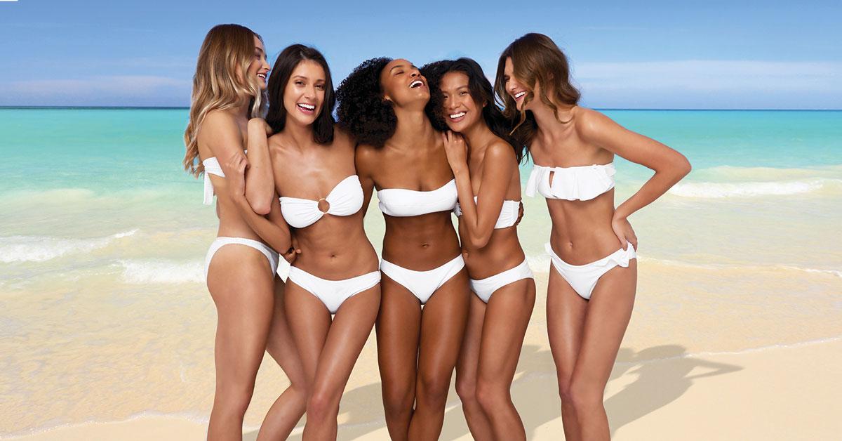 Tanned women on a beach - fake tan